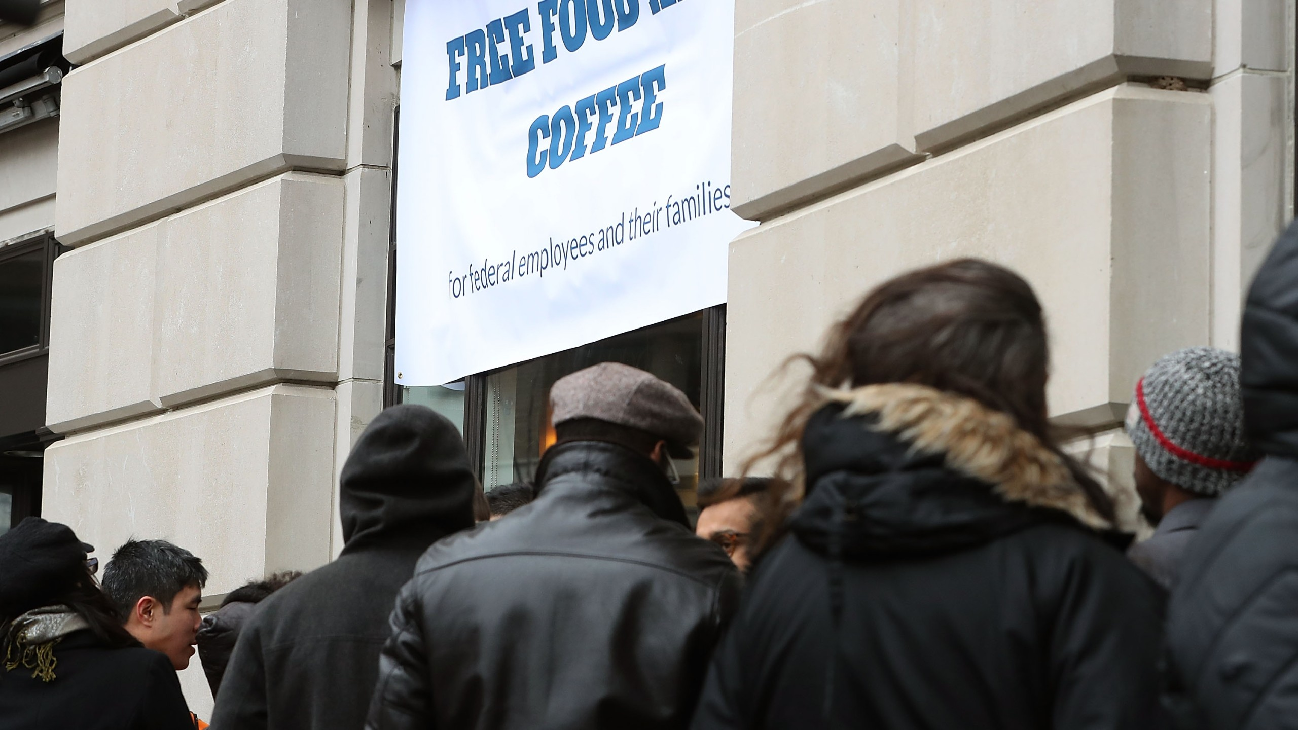 People line up to get a free lunch at a pop-up eatery hosted by Celebrity Chef Jose Andres for furloughed government employees and their families, on Jan. 16, 2019, in Washington D.C. (Credit: Mark Wilson / Getty Images)