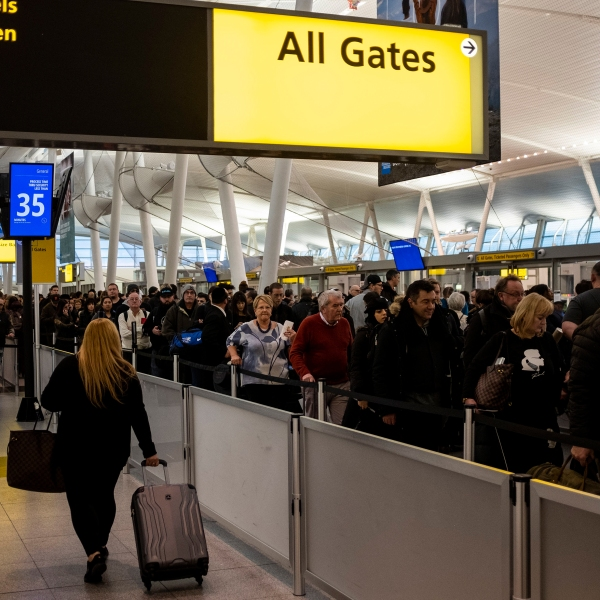Passengers wait in a Transportation Security Administration line at JFK Airport on January 17, 2019 in New York City. (Credit: JOHANNES EISELE/AFP/Getty Images)