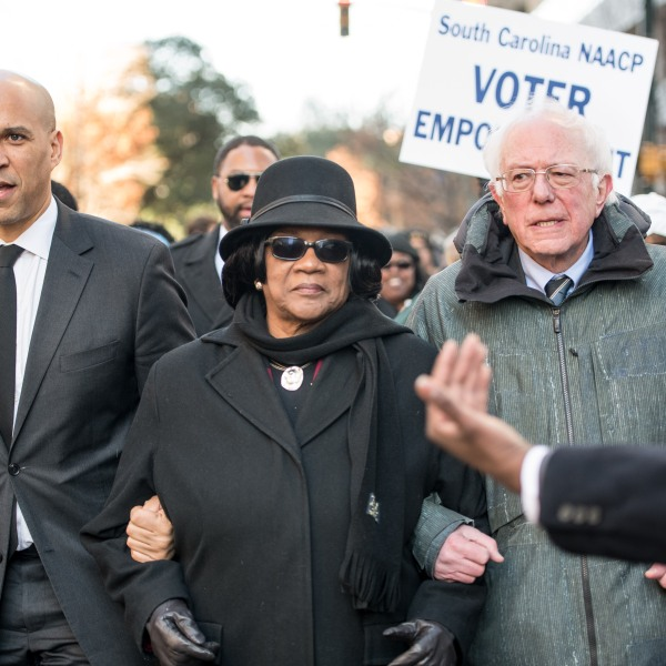 U.S. Sen. Bernie Sanders (I-VT), right, president of the South Carolina NAACP chapter, Brenda Murphy, center, and Sen. Cory Booker (D-NJ) march to the Statehouse in commemoration of Martin Luther King Jr. Day on Jan. 21, 2019, in Columbia, South Carolina. (Credit: Sean Rayford/Getty Images)