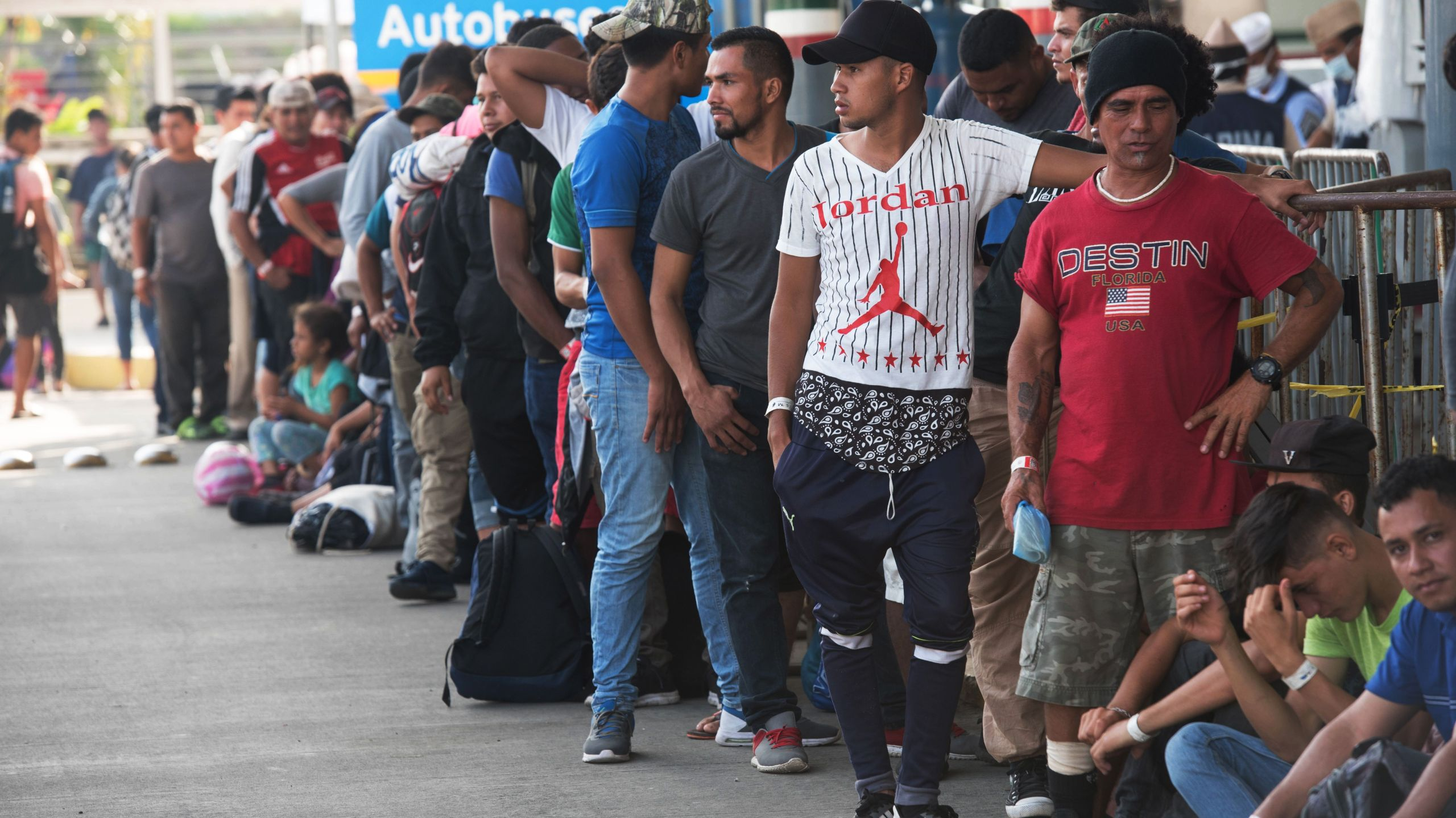 Central American migrants heading to the United States with a second caravan wait for immigration officials to give them their visitor card to continue on their journey, in Ciudad Hidalgo, Chiapas state, southern Mexico on Jan. 21, 2019. (Credit: Alejandro Melendez / AFP / Getty Images)