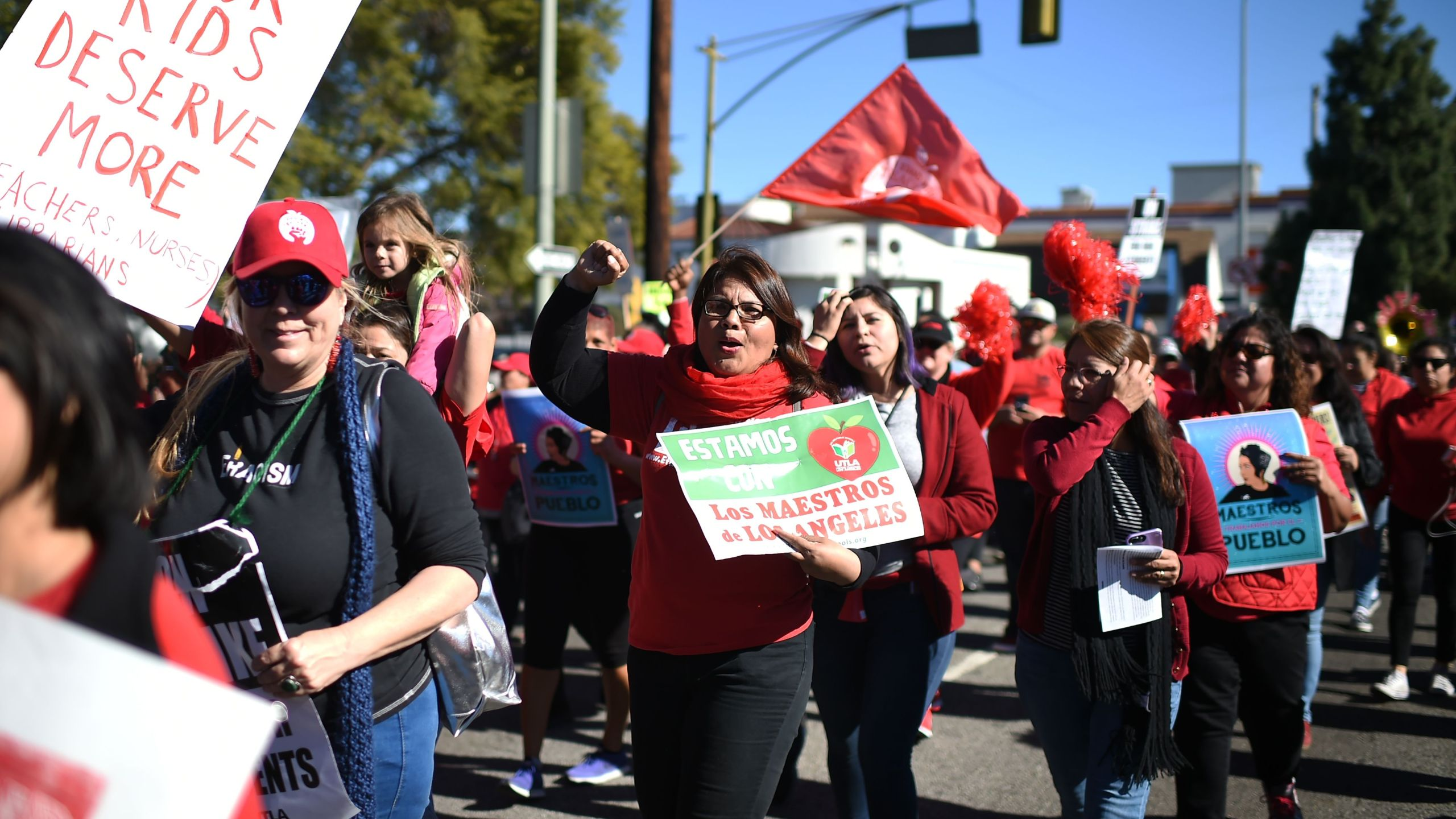 Striking public school teachers and their supporters march during the 34th annual Kingdom Day Parade on Martin Luther King Jr. Day on Jan. 21, 2019. (Credit: Robyn Beck / AFP/Getty Images)
