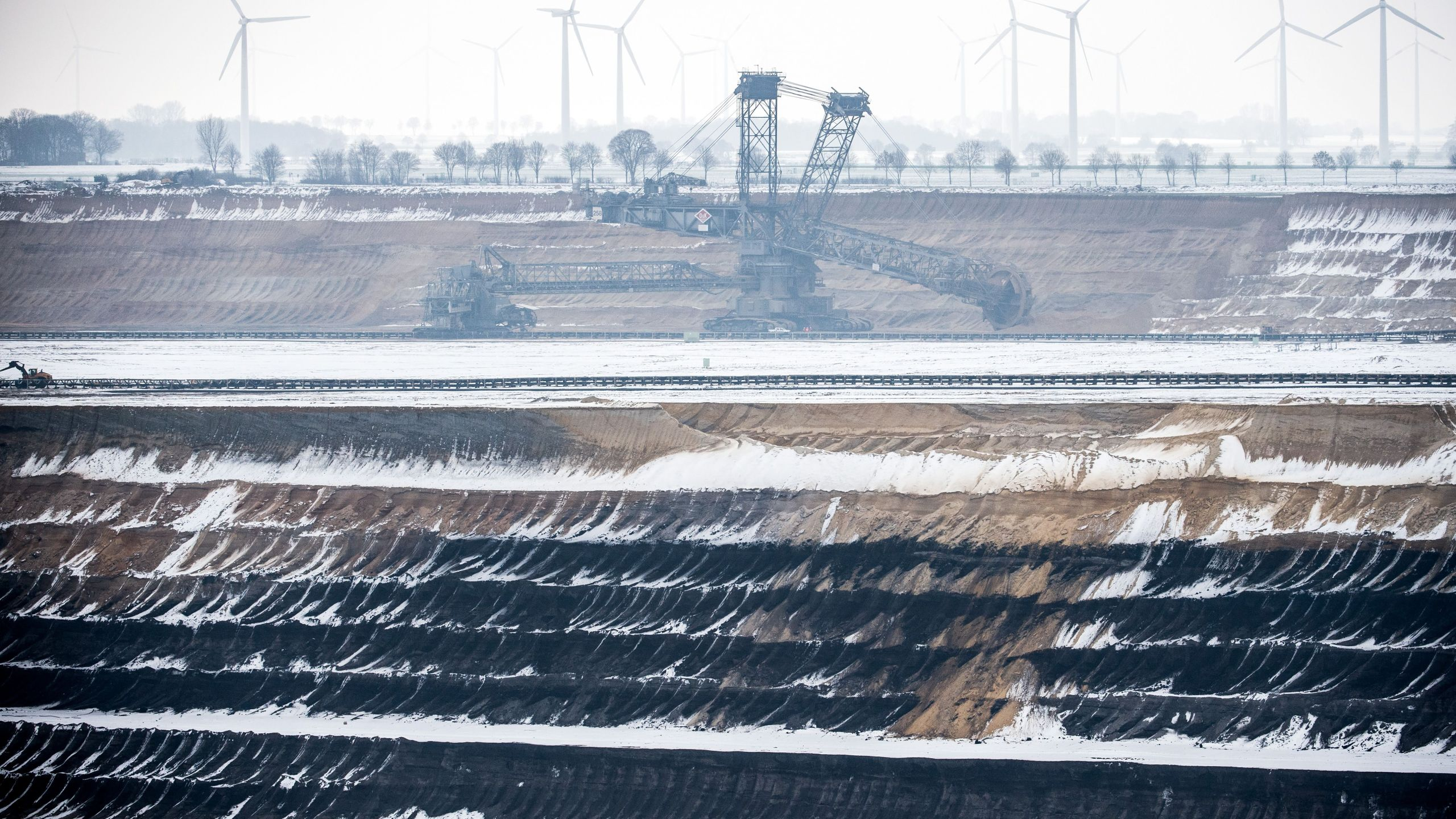 A bucket wheel excavator operates to dig brown coal at the Garzweiler lignite opencast mine in Jackerath, western Germany, on Jan. 25, 2019. (Credit: FEDERICO GAMBARINI/AFP/Getty Images)