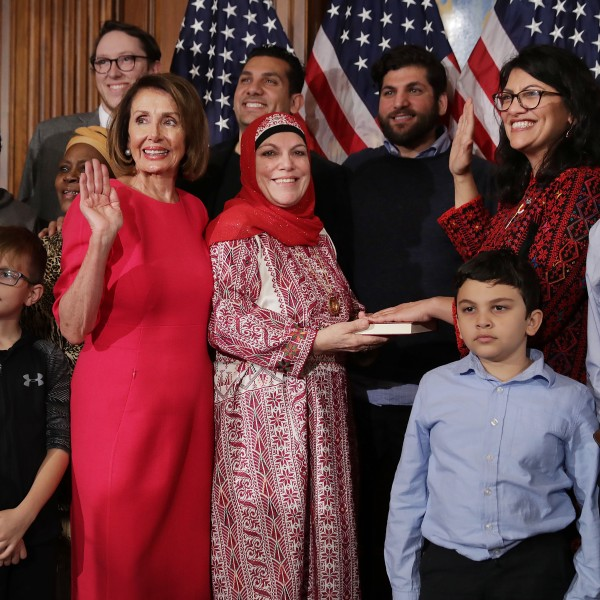 Speaker of the House Nancy Pelosi (D-CA) poses for photographs with Rep. Rashida Tlaib (D-MI) and her family in the Rayburn Room at the U.S. Capitol on Jan. 03, 2019. (Credit: Chip Somodevilla/Getty Images)