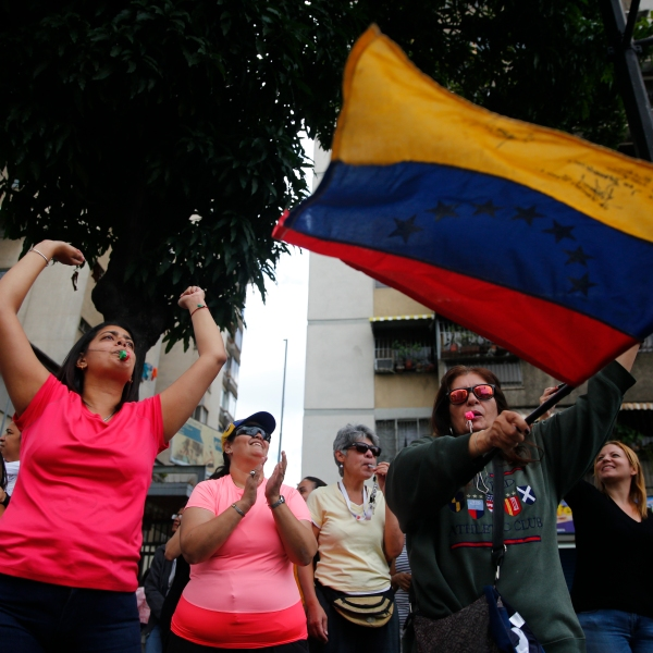 People shout during a demonstration against the government of President Nicolás Maduro on Jan. 30, 2019, in Caracas, Venezuela. (Credit: Marco Bello/Getty Images)