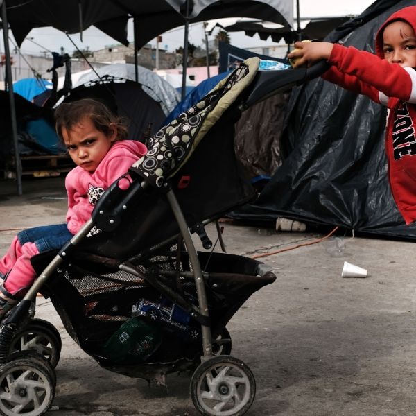 Children who arrived as part of the migrant caravan play in the El Barretal migrant shelter on Jan. 18, 2019, in Tijuana, Mexico. (Credit: Spencer Platt / Getty Images)