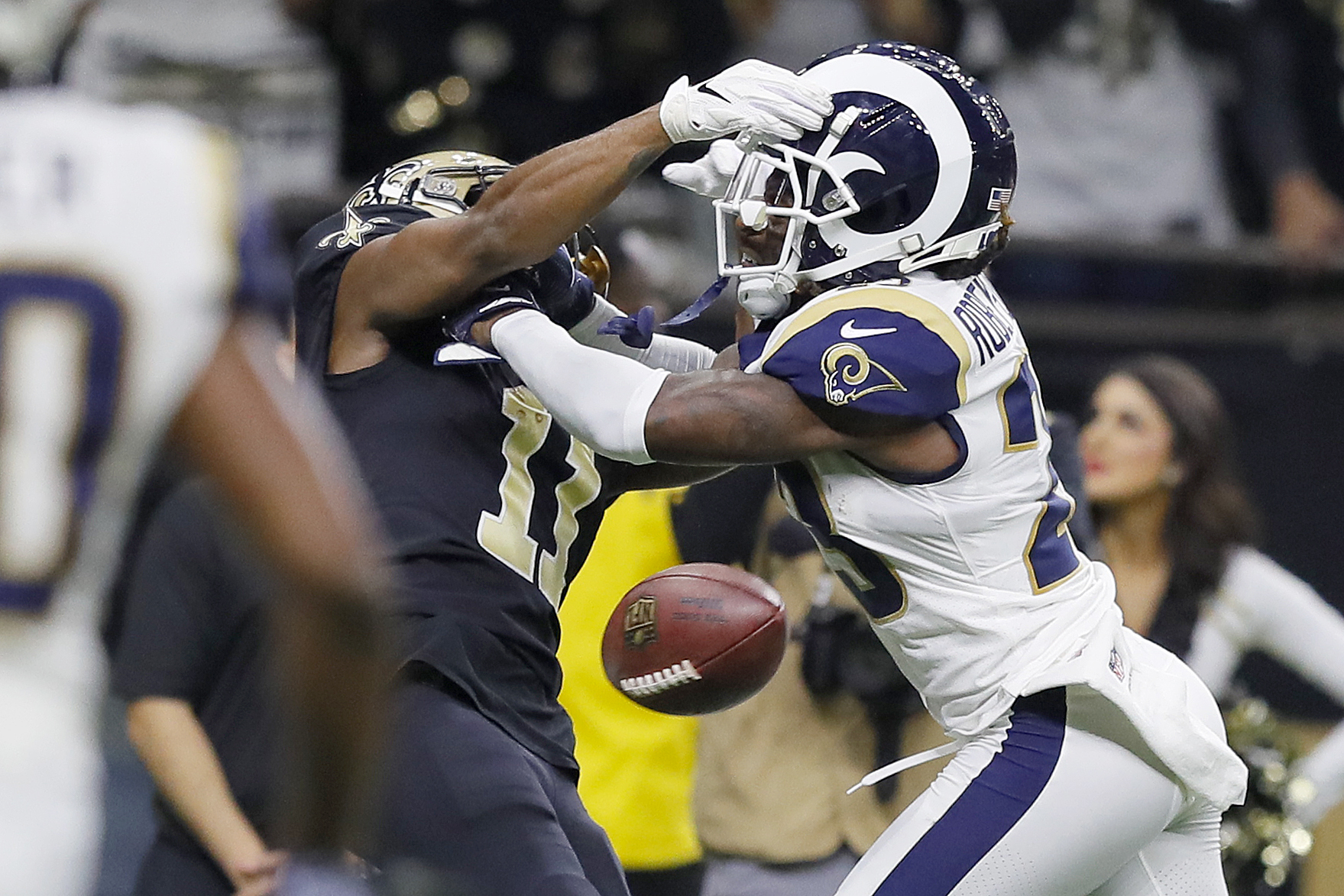 Tommylee Lewis #11 of the New Orleans Saints drops a pass broken up by Nickell Robey-Coleman #23 of the Los Angeles Rams during the fourth quarter in the NFC Championship game at the Mercedes-Benz Superdome on January 20, 2019 in New Orleans, Louisiana. (Credit: Kevin C. Cox/Getty Images)