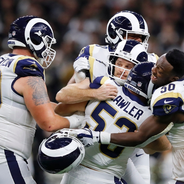 Johnny Hekker #6 and Greg Zuerlein #4 of the Los Angeles Rams celebrate after kicking the game winning field goal in overtime against the New Orleans Saints in the NFC Championship game at the Mercedes-Benz Superdome in New Orleans on Jan. 20, 2019. (Credit: Kevin C. Cox / Getty Images)