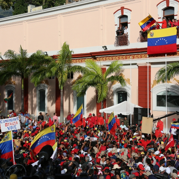 President of Venezuela Nicolás Maduro (center) gives a speech to his supporters form the Balcón del Pueblo of the Miraflores Government Palace on Jan. 23, 2019. (Credit: Edilzon Gamez/Getty Images)