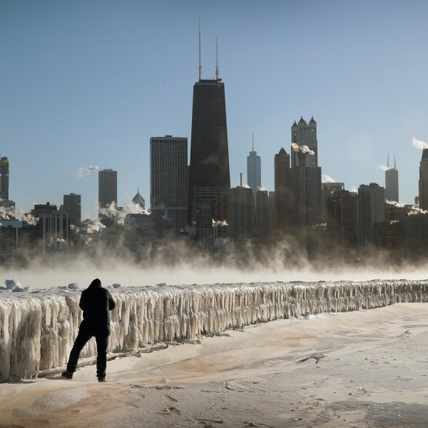 A man takes a picture along the lakefront as temperatures hovered around -20 degrees in Chicago on Jan. 30, 2019. (Credit: Scott Olson / Getty Images)