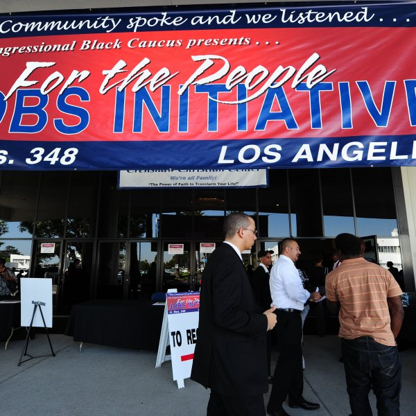 In this file photo, Job seekers arrive at an outdoor job fair at the Crenshaw Christian Center in South L.A. (Credit: ROBYN BECK/AFP/Getty Images)