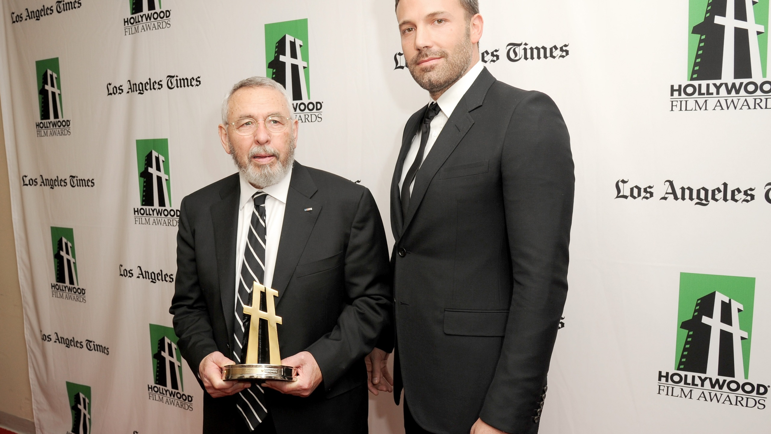 Actor Ben Affleck (R), winner of the Hollywood Ensemble Acting Award, poses with former CIA Officer Tony Mendez during the 16th Annual Hollywood Film Awards Gala presented by The Los Angeles Times held at The Beverly Hilton Hotel on October 22, 2012 in Beverly Hills, California. (Credit: Jason Merritt/Getty Images)