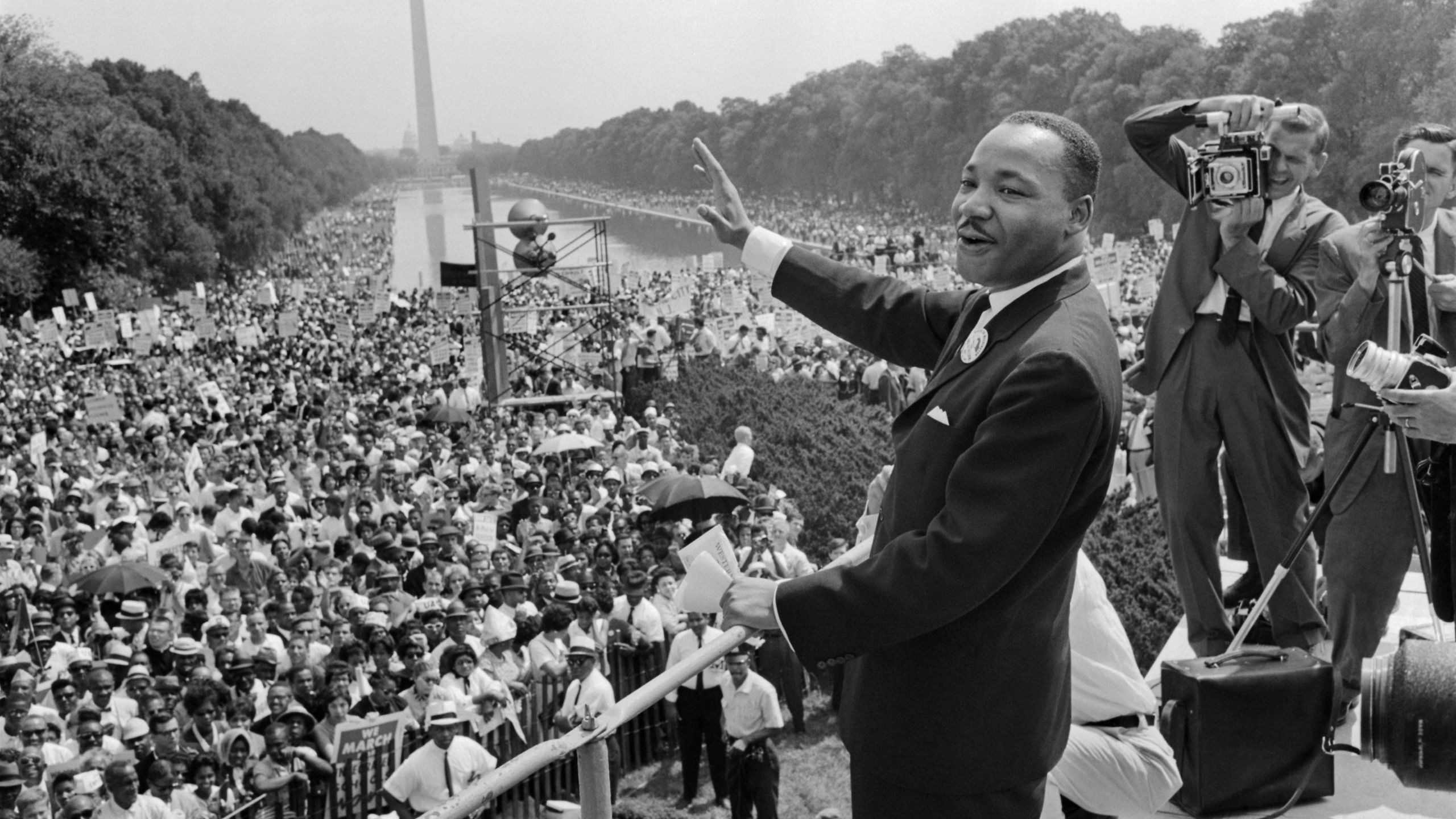 "Civil rights leader Martin Luther King Jr. waves to supporters Aug. 28, 1963, on the National Mall in Washington, D.C. during the ""March on Washington."" (Credit: AFP/Getty Images)"