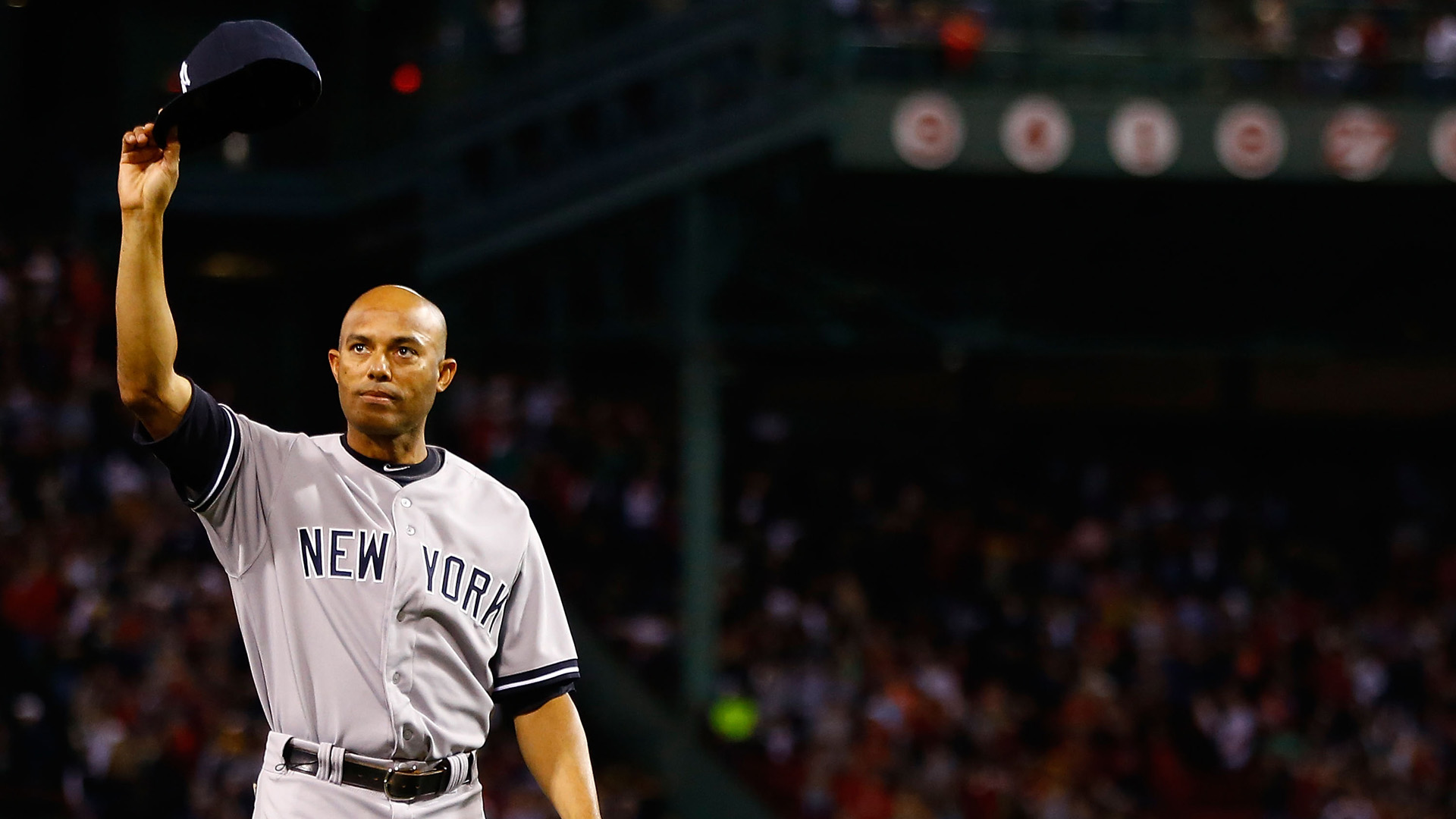 Mariano Rivera #42 of the New York Yankees tips his hat to the crowd after being honored prior to the game against the Boston Red Sox on September 15, 2013 at Fenway Park in Boston, Massachusetts. (Credit: Jared Wickerham/Getty Images)