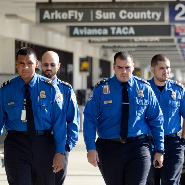 Transportation Security Administration agents walk on the departures level a day after a shooting that killed one Transportation Security Administration worker and injured several others at Los Angeles International Airport November 2, 2013 in Los Angeles, California.(Credit: Kevork Djansezian/Getty Images)