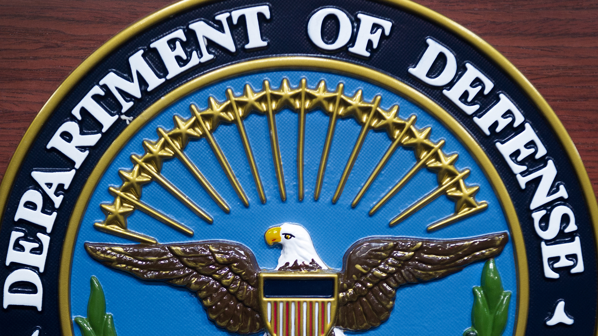The U.S. Department of Defense seal is seen on the lectern in the media briefing room at the Pentagon Dec. 12, 2013, in Washington, D.C. (Credit: Paul J. Richards/AFP/Getty Images)