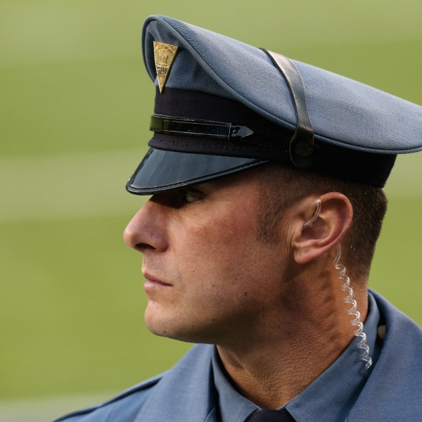 A New Jersey State Trooper looks on before the Seattle Seahawks take on the Denver Broncos during Super Bowl XLVIII at MetLife Stadium on February 2, 2014 in East Rutherford, New Jersey. (Credit: Stephen Dunn/Getty Images)