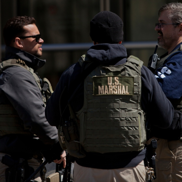 U.S. Marshals stand outside U.S. Federal Court in Brooklyn during the arraignment on a case involving terrorist charges on April 2, 2015. (Credit: Victor J. Blue/Getty Images)