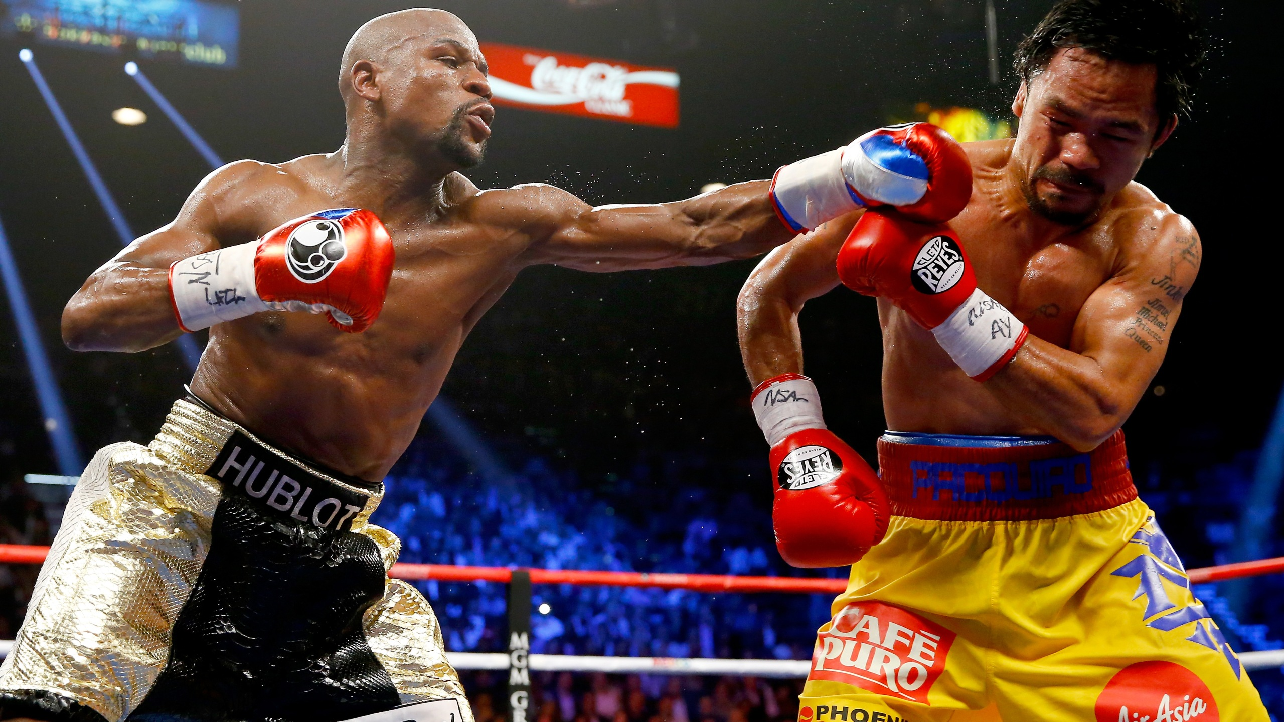Floyd Mayweather Jr. throws a left at Manny Pacquiao during their welterweight unification championship bout on May 2, 2015 at MGM Grand Garden Arena in Las Vegas, Nevada. (Credit: Al Bello/Getty Images)