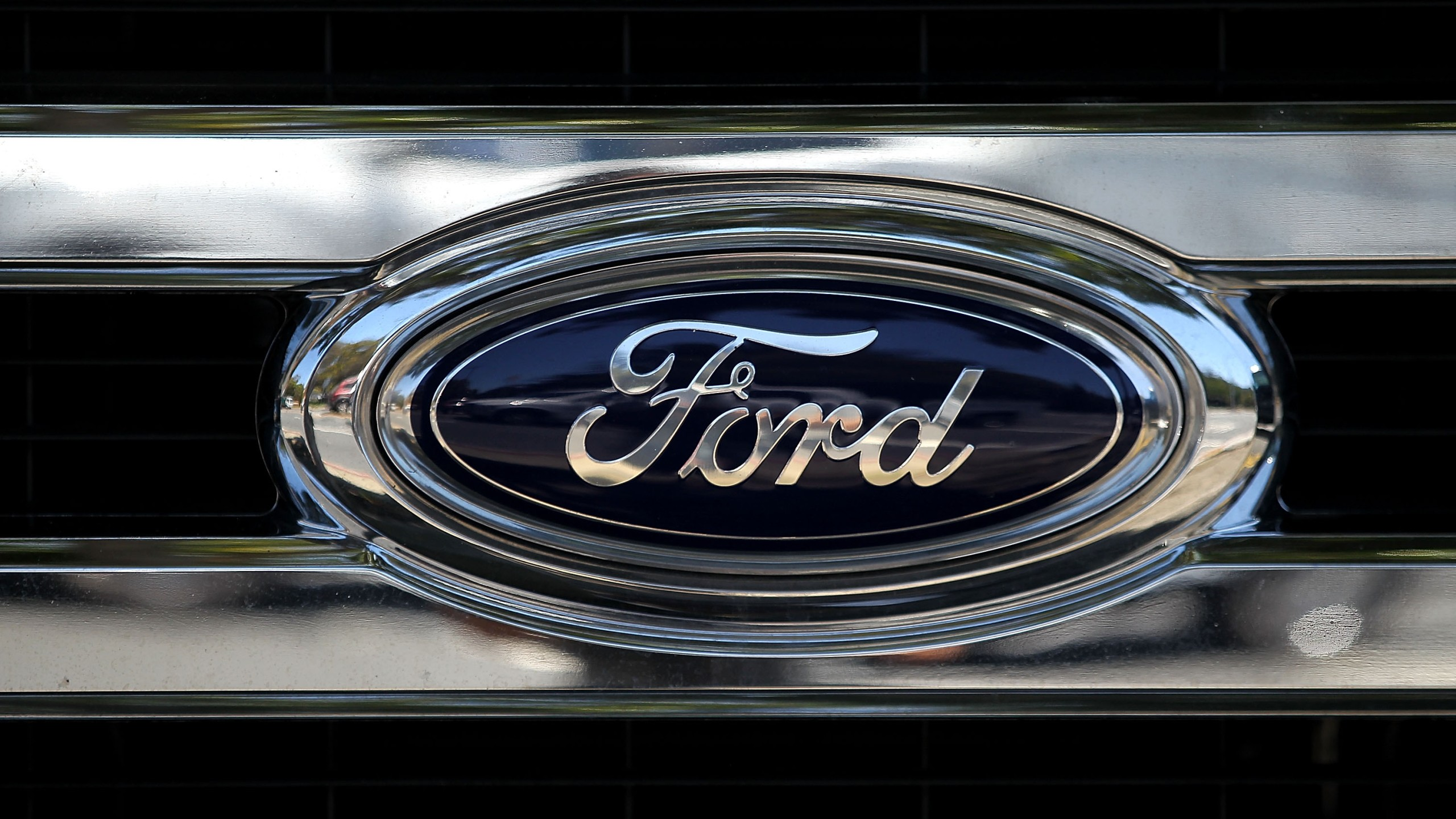The Ford logo is displayed on the front of a brand new Ford truck at Serramonte Ford on July 28, 2015 in Colma. (Credit: Justin Sullivan/Getty Images)