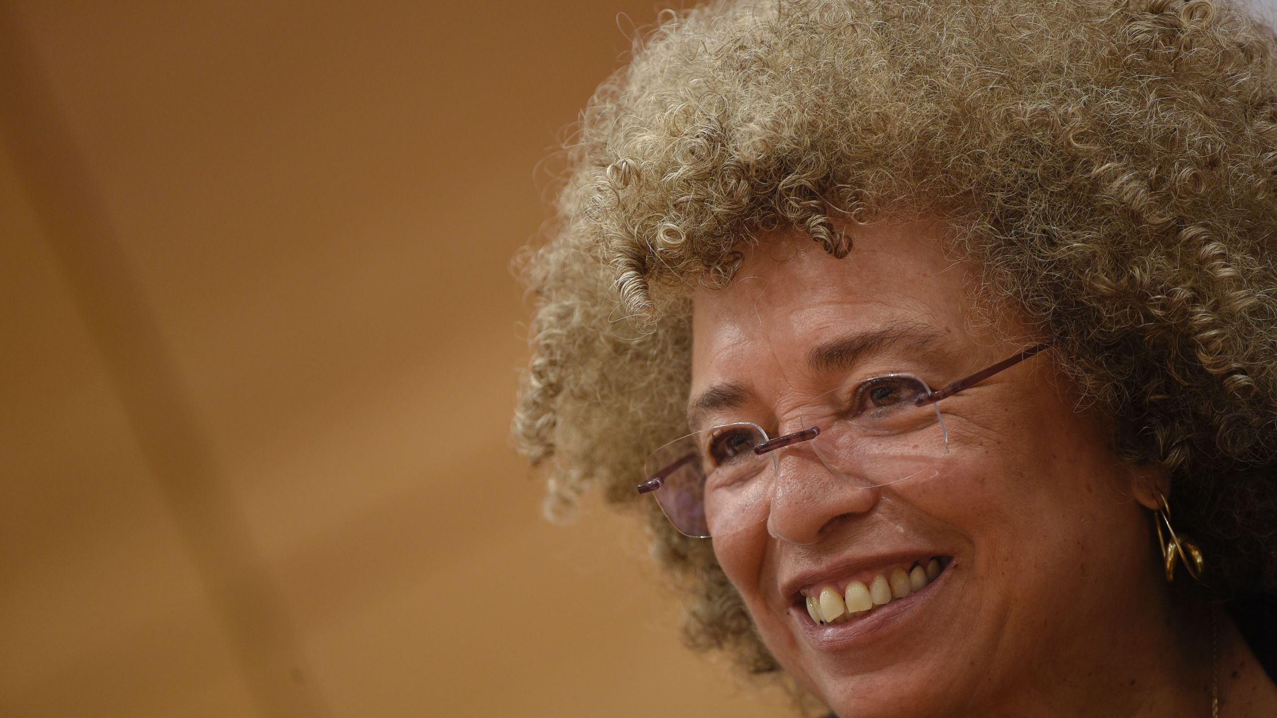 "U.S. political civil-rights activist Angela Davis attends a meeting ""The meaning of white supremacy today"", held at ""Roma TRE University"" , on March 14, 2016, in Rome. (Credit: ANDREAS SOLARO/AFP/Getty Images)"