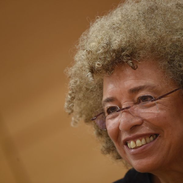 """U.S. political civil-rights activist Angela Davis attends a meeting """"The meaning of white supremacy today"""", held at """"Roma TRE University"""" , on March 14, 2016, in Rome. (Credit: ANDREAS SOLARO/AFP/Getty Images)"""
