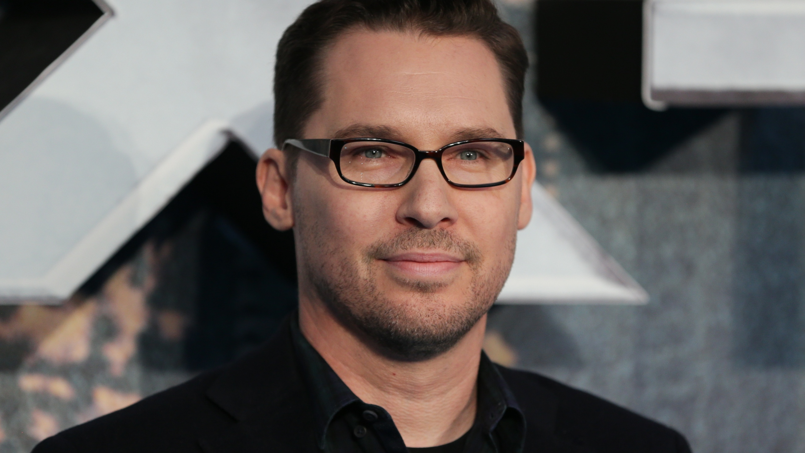 "Director Bryan Singer poses on arrival for the London premiere of ""X-Men: Apocalypse"" on May 9, 2016. (Credit: Daniel Leal-Olivas / AFP / Getty Images)"