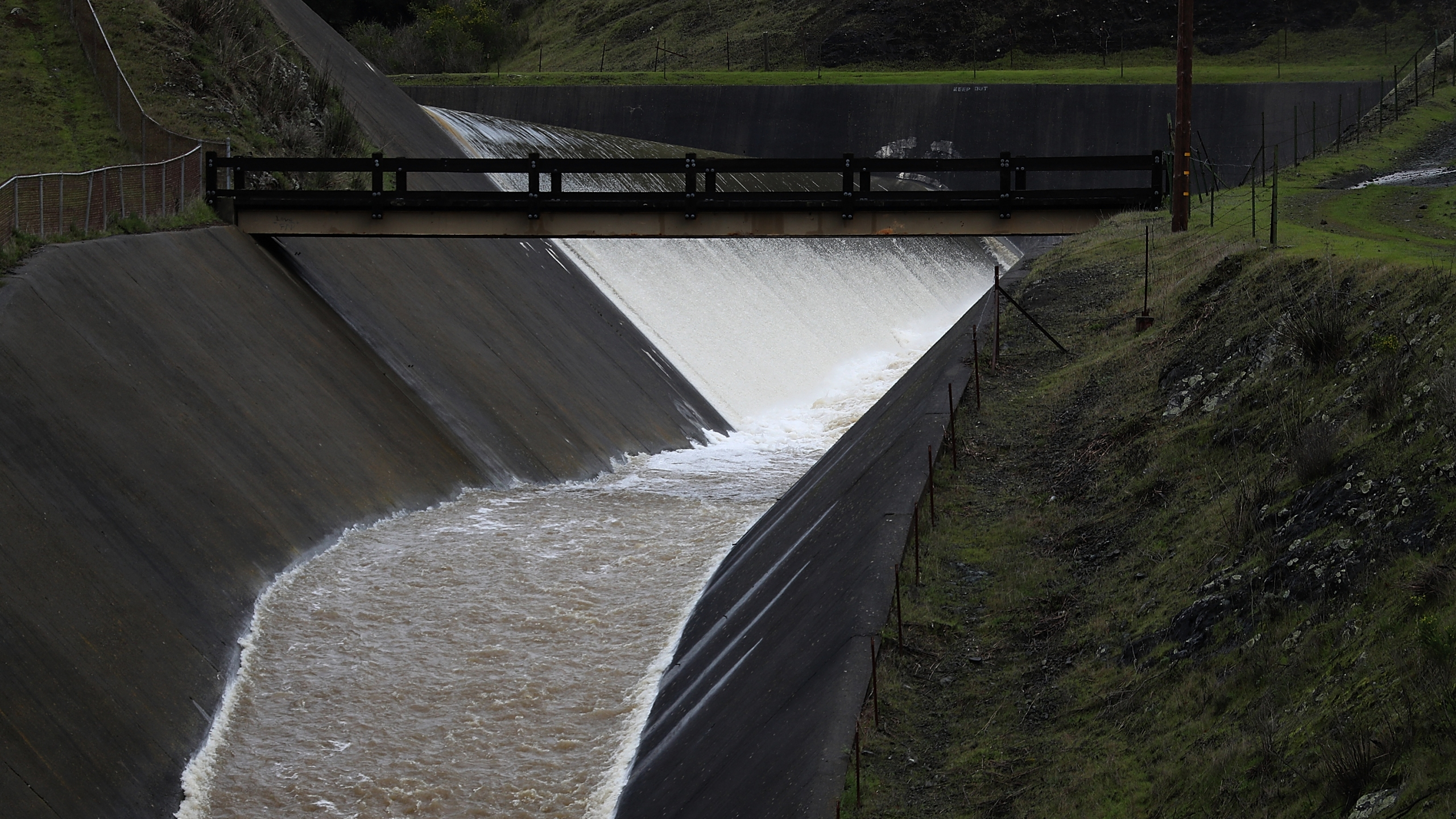 In this file photo, water pours down a spillway out of Nicasio Reservoir in Nicasio on Jan. 12, 2017. (Credit: Justin Sullivan/Getty Images)