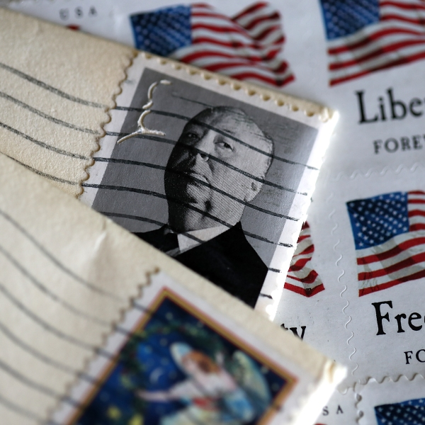 U.S. Postal Service stamps are displayed on May 10, 2017 in San Anselmo. (Credit: Justin Sullivan/Getty Images)