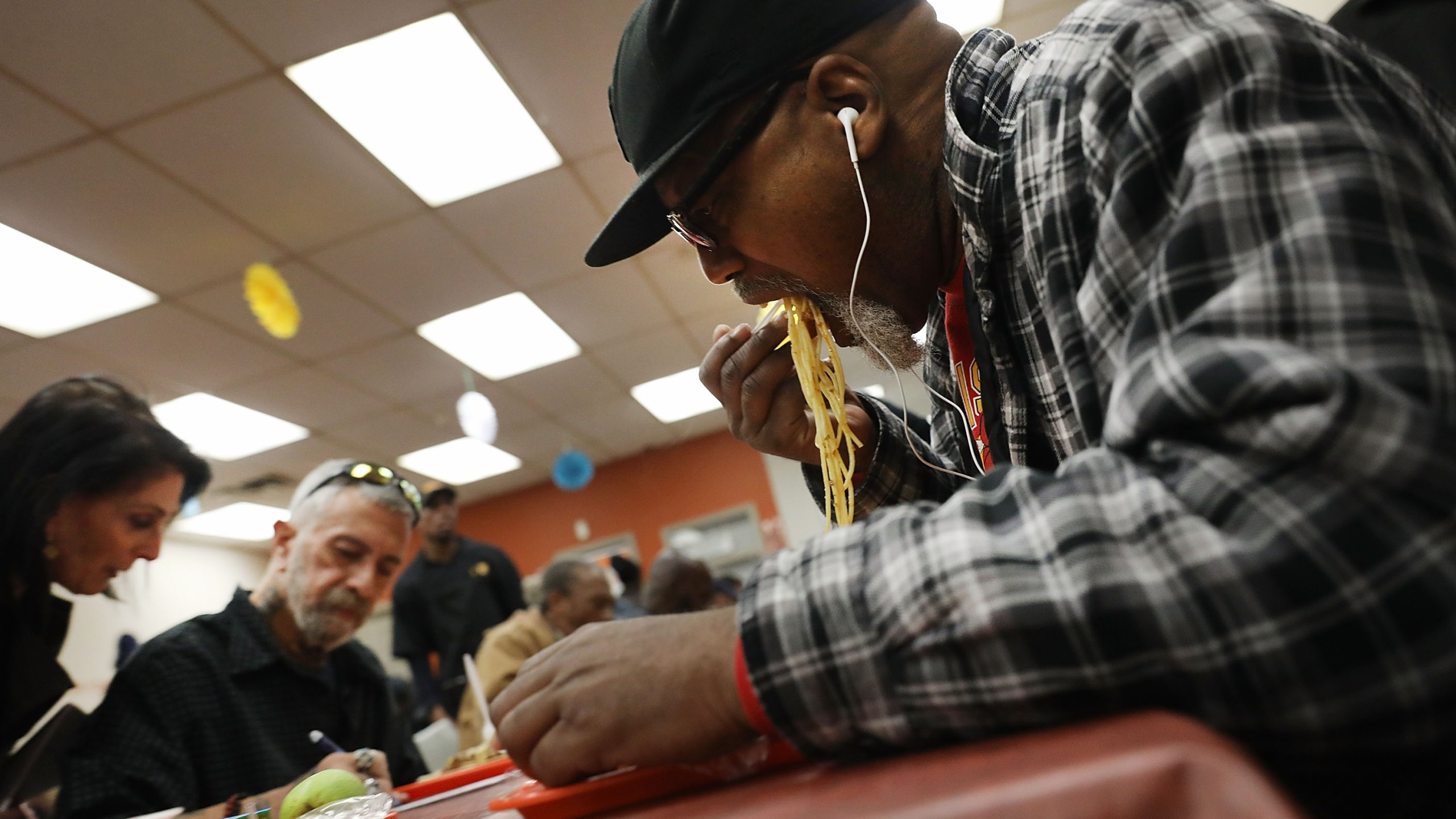 Cecil Sears receives an evening meal at the Food Bank For New York City community kitchen on May 15, 2017, in New York City. (Credit: Spencer Platt/Getty Images)
