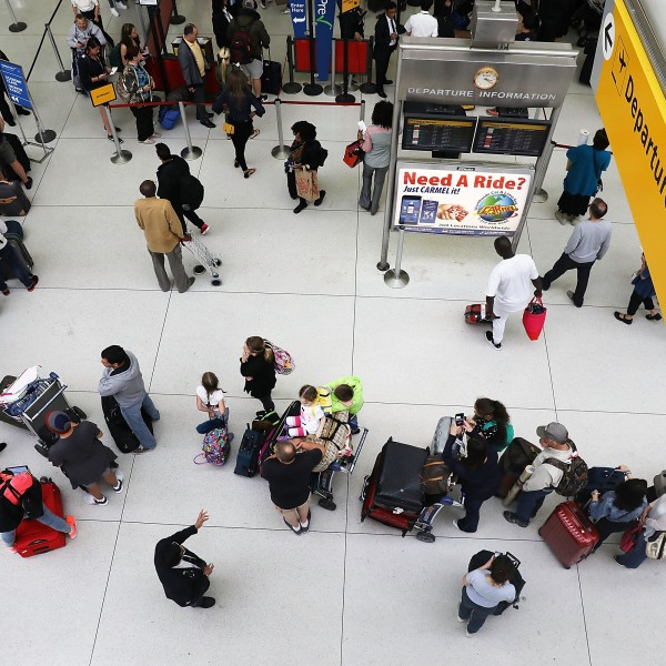 People wait in a security line at John F. Kennedy International Airport (JFK) on June 5, 2017 in New York City. (Credit: by Spencer Platt/Getty Images)