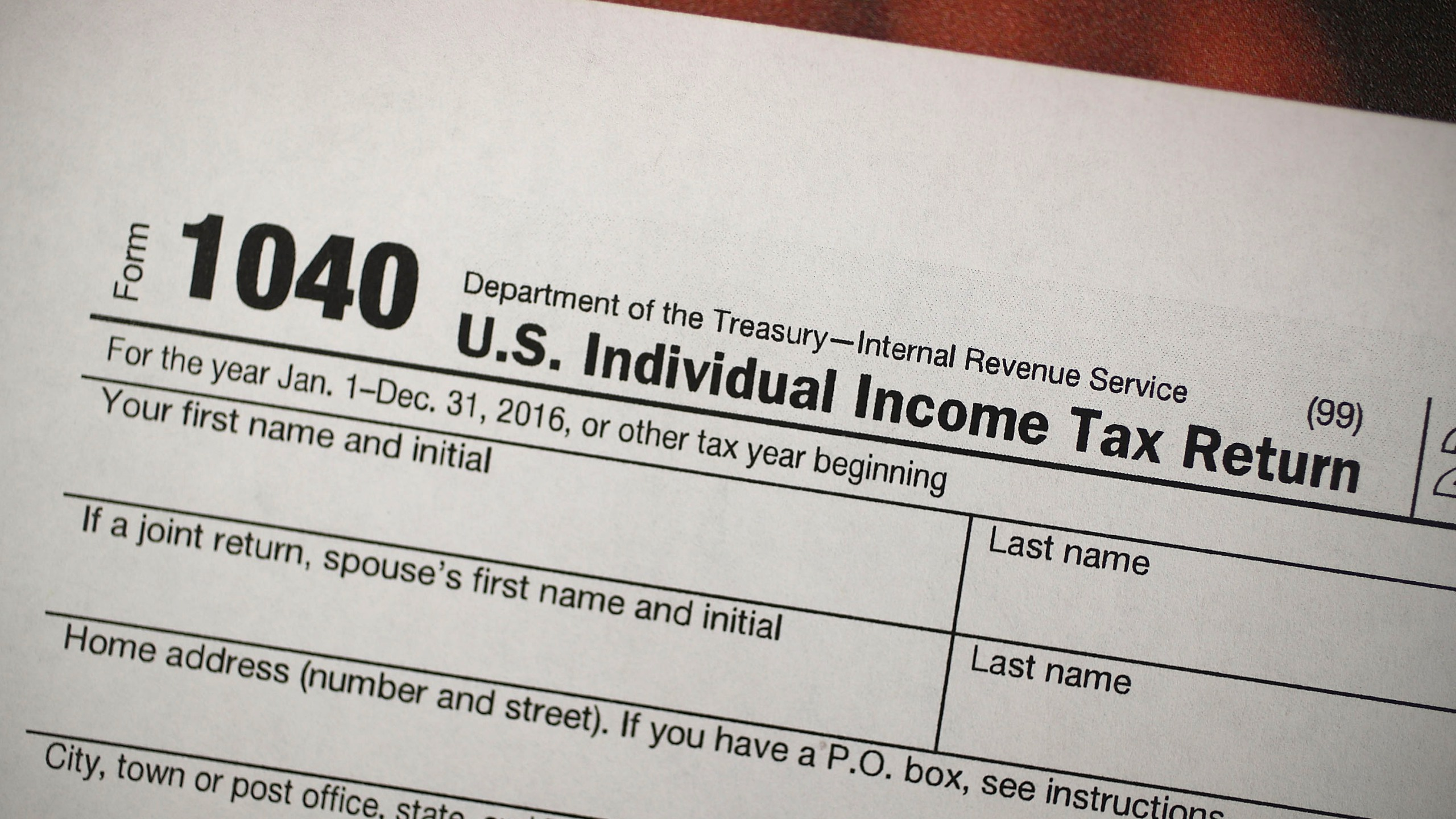 A copy of a IRS 1040 tax form is seen at an H&R Block office in this file photo.(Credit: Joe Raedle/Getty Images)