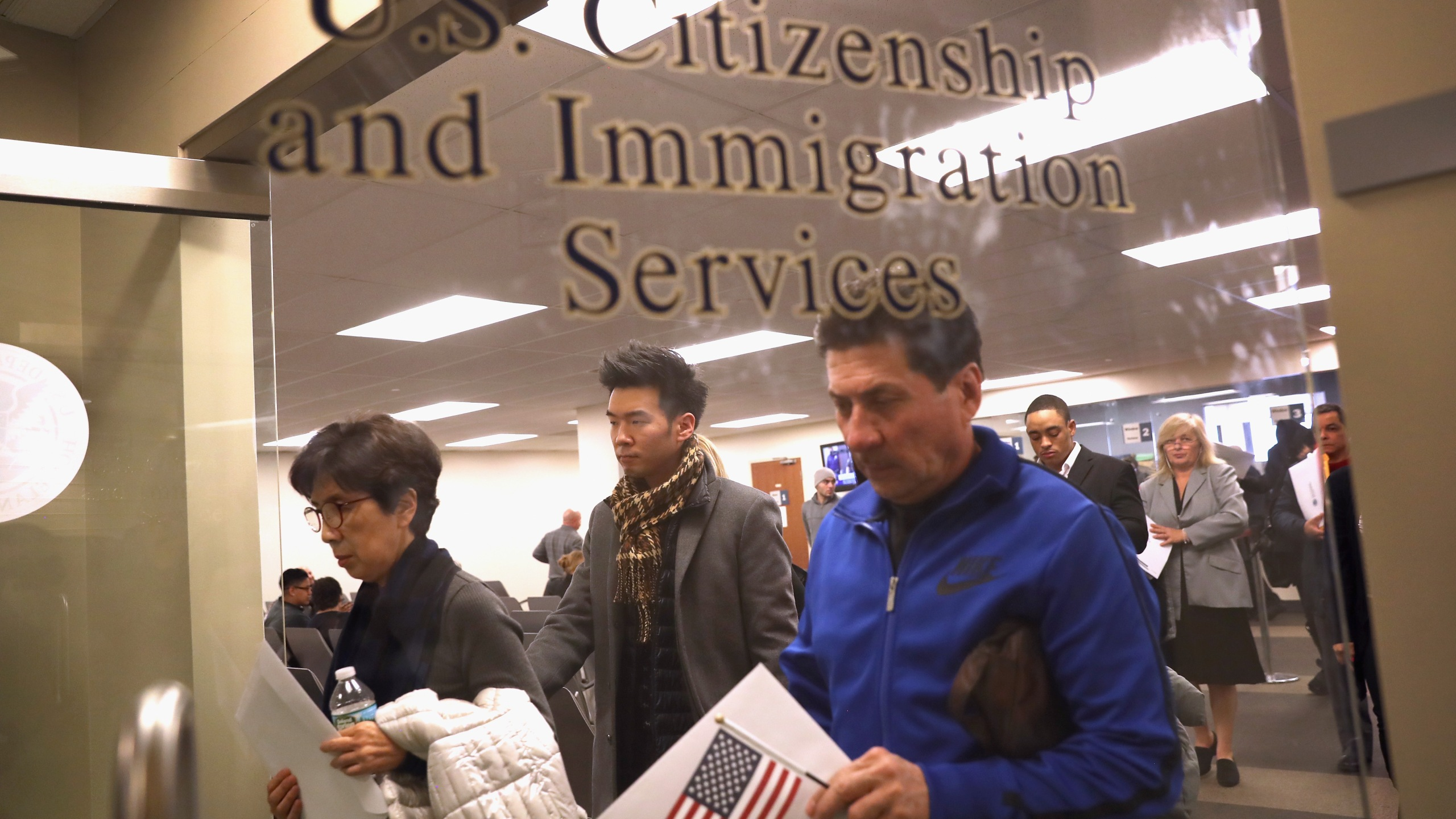 Immigrants prepare to become American citizens at a naturalization service on Jan. 22, 2018 in Newark, New Jersey. Although much of the federal government was shut down Monday morning, the U.S. Citizenship and Immigration Services offices remained open nationwide that day. (Credit: John Moore/Getty Images)