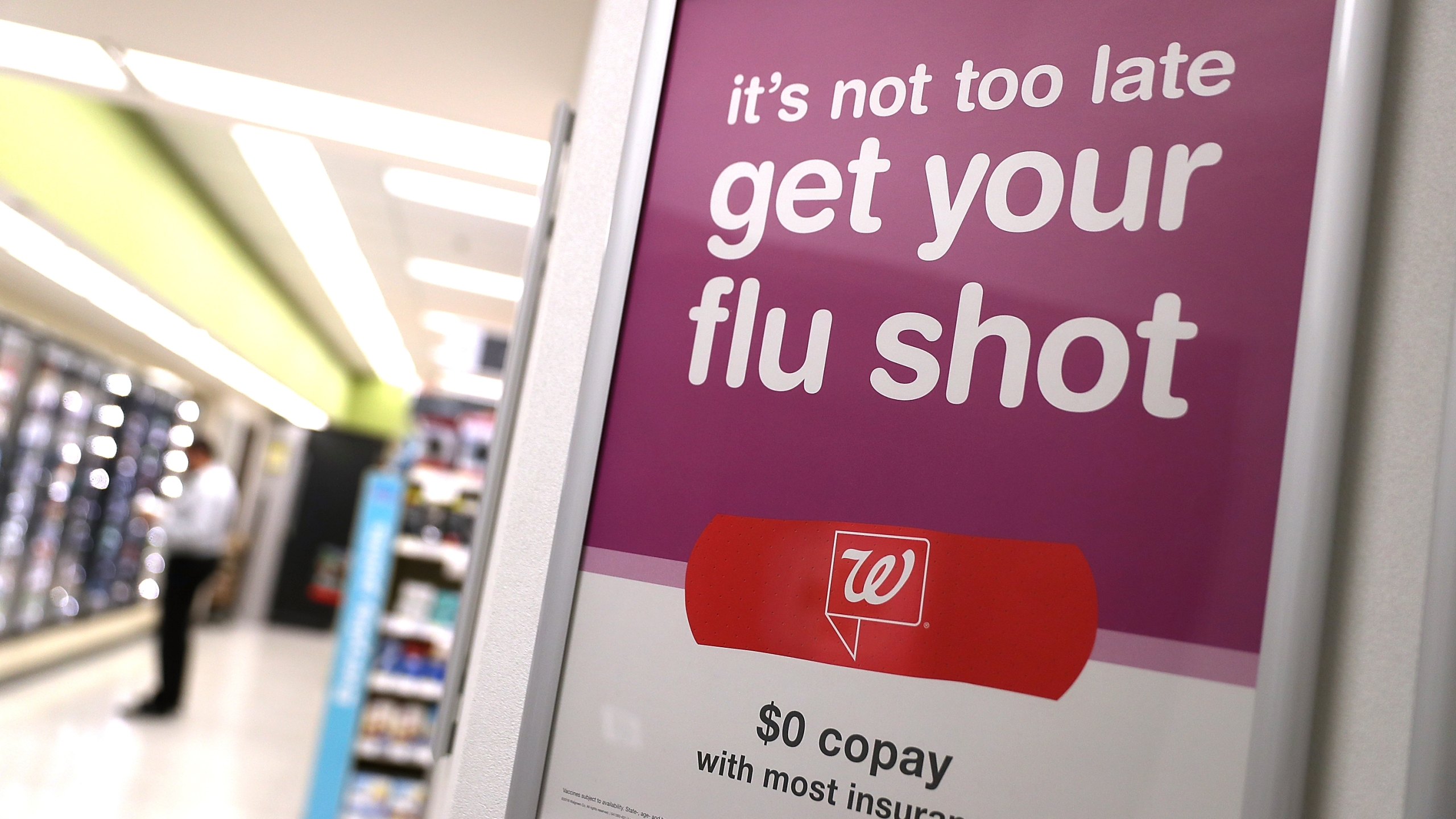 A sign advertising flu shots is displayed at a Walgreens phramacy on January 22, 2018 in San Francisco. (Credit: Justin Sullivan/Getty Images)