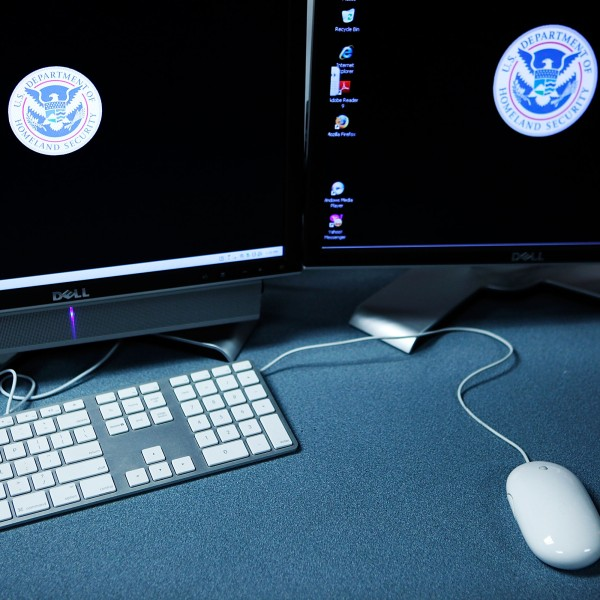 The logos of the U.S. Department of Homeland Security are seen on computer terminals in a training room of the Cyber Crimes Center of the U.S. Immigration and Customs Enforcement October 13, 2009 in Fairfax, Virginia. (Credit: Alex Wong/Getty Images)