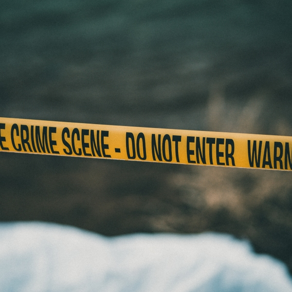A crime scene with yellow police tape is shown in a file photo. (Credit: E+ via Getty Images)
