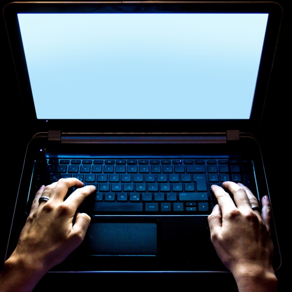 A file image shows a person using a laptop. (Credit: iStock / Getty Images Plus)
