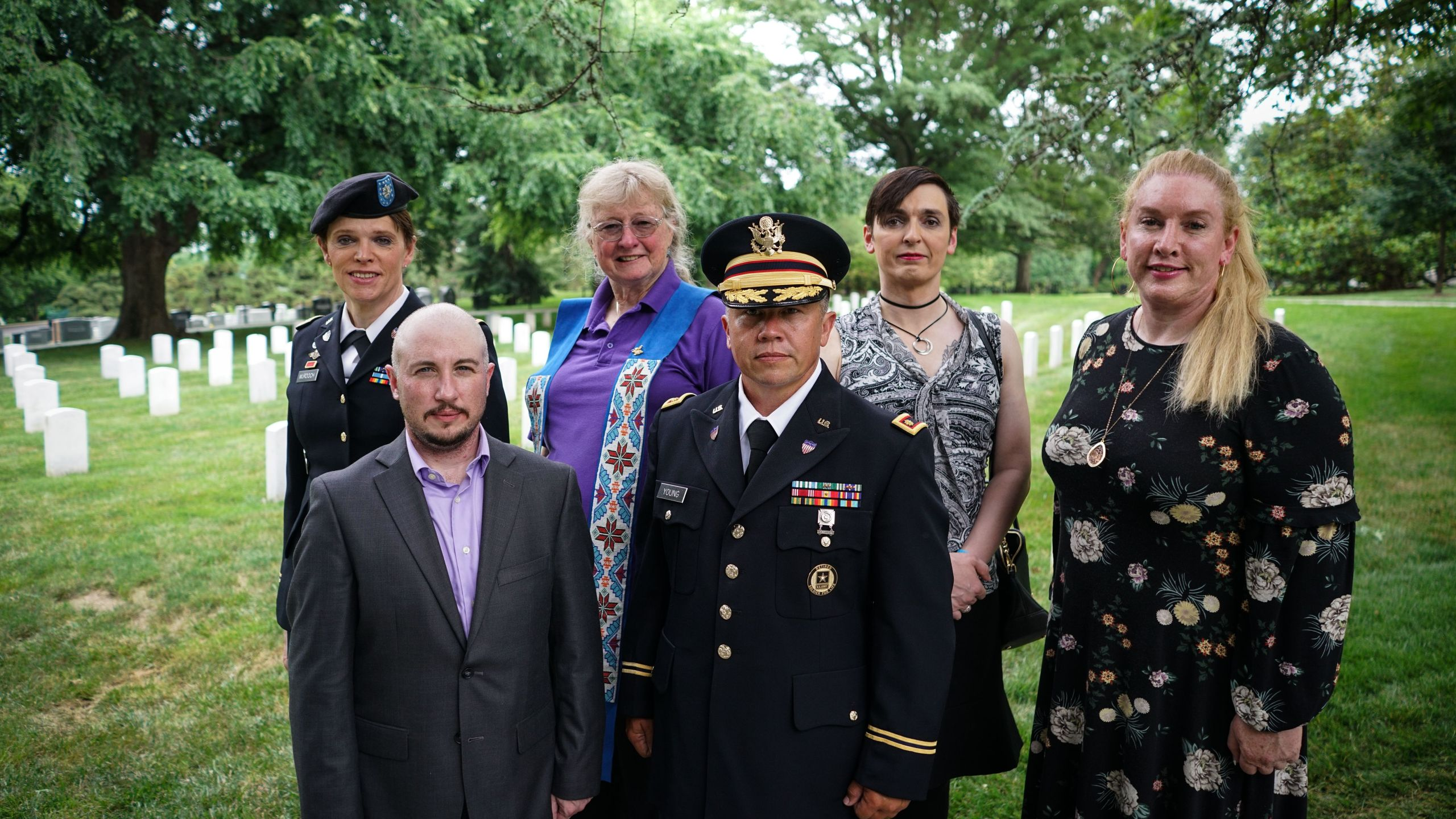From left: Retired Army lieutenant colonel Ann Murdoch; Transgender American Veterans Association Vice President Gene Silvestri; Yvonne Cook-Riley; retired Army major and Transgender American Veterans Association President Evan Young; petty officer first class Alice Ashton; and retired Air Force major Nella Ludlow pose for a photo in Arlington National Cemetery after attending a wreath laying ceremony at the Tomb of the Unknown Soldier on June 8, 2018. (Credit: MANDEL NGAN/AFP/Getty Images)