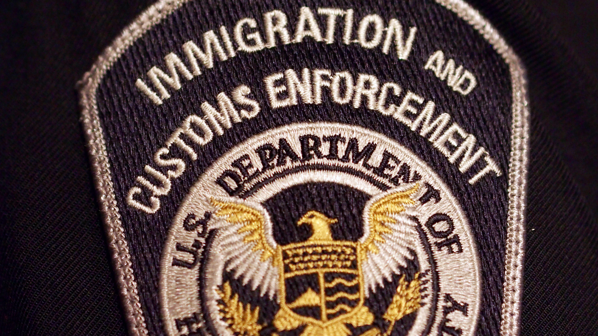 A U.S. Immigration and Customs Enforcement badge is seen in a file photo. (Credit: Robert MacPherson / AFP / Getty Images)