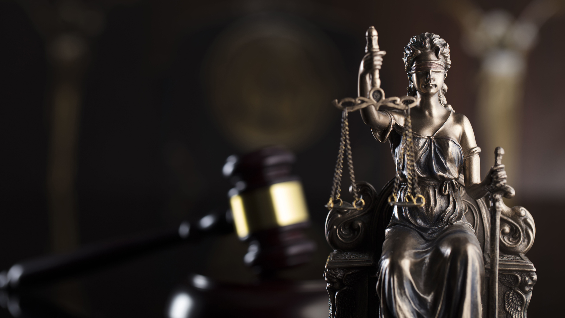 Lady Justice is shown blindfolded on a judge's desk in a file image. (Credit: iStock / Getty Images Plus)