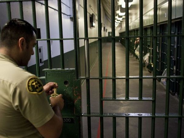 A Los Angeles County sheriff's deputy prepares to unlock a security door at the L.A. County Men's Central Jail in this undated photo. (Credit: Jay L. Clendenin / Los Angeles Times)
