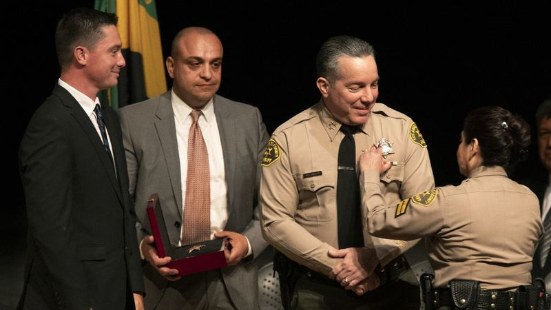 Caren Carl Mandoyan, second from left, looks on during L.A. County Sheriff Alex Villanueva's swearing-in ceremony in December 2018. (Credit: Mel Melcon / Los Angeles Times)