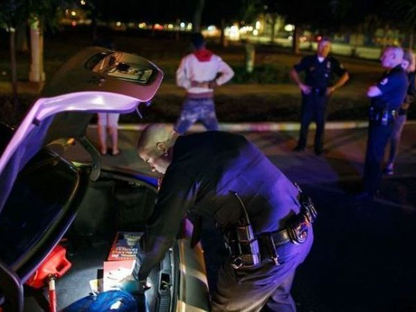 Sometime in 2015, an LAPD Metro officer searches the vehicle of a person who has been pulled over. (Credit: Marcus Yam/Los Angeles Times)