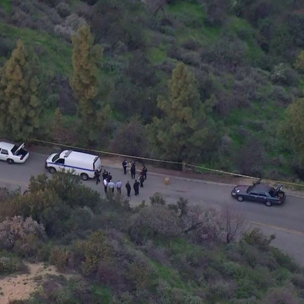 Officials are seen in the area where a woman's dead body was discovered at Griffith Park on Jan. 29, 2019. (Credit: KTLA)