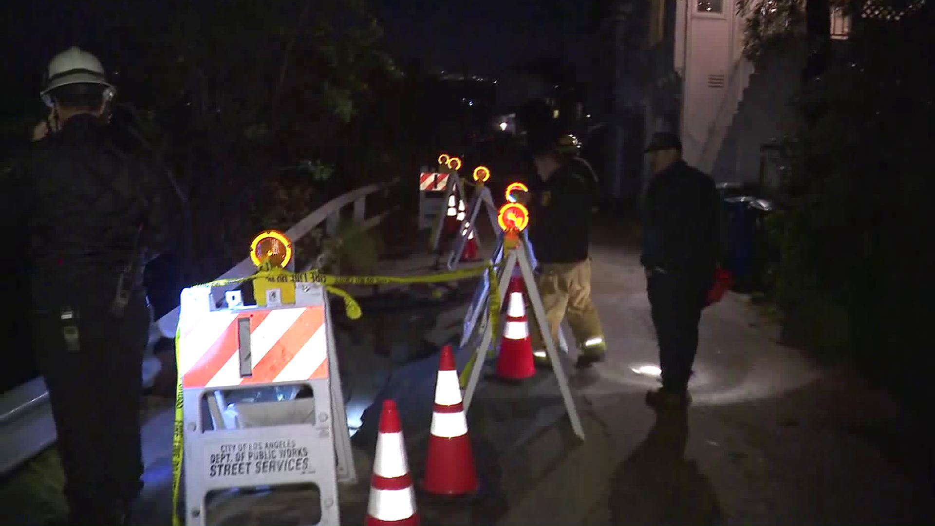 Fire officials respond after a portion of Mannix Drive collapsed in Laurel Canyon and the hillside underneath slid down on Jan. 17, 2019. (Credit: KTLA)