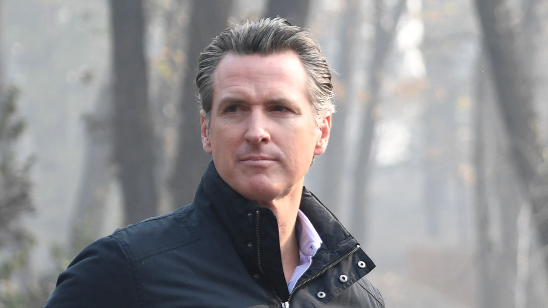Then-Lt. Gov. Gavin Newsom views damage from wildfires in Paradise, Calif. on Nov. 17, 2018. (Credit: SAUL LOEB/AFP/Getty Images)