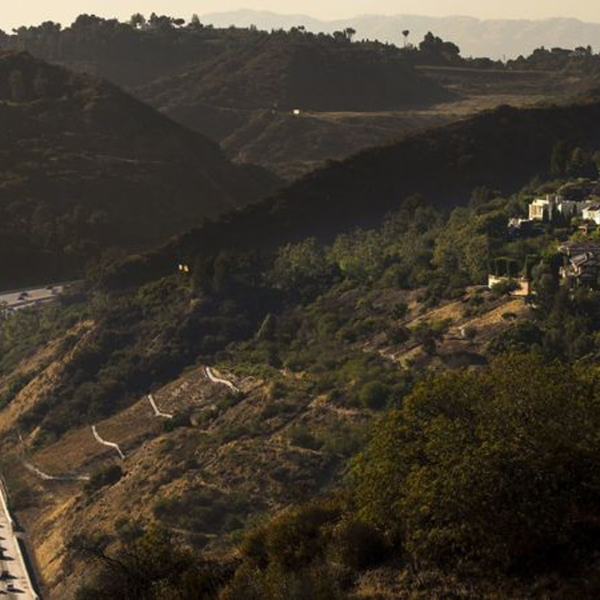 Traffic streams through the Sepulveda Pass, one of Southern California's most infamous bottlenecks. Metro says a new rail line could whisk commuters through the mountains and into West L.A. in as little as 15 minutes. (Credit: Kent Nishimura / Los Angeles Times)