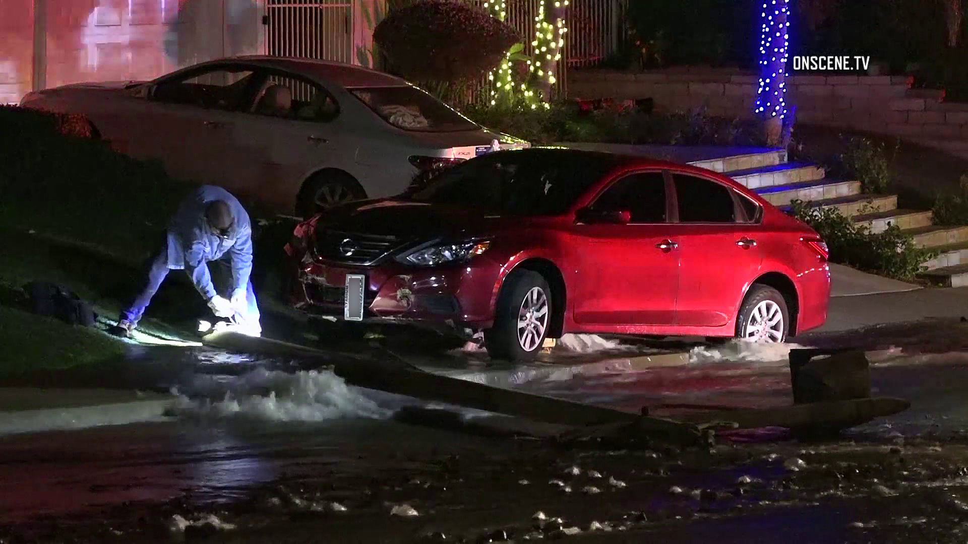 Water streams into the street after a car crashed into a hydrant in Anaheim on Jan. 2, 2019. (Credit: OnScene.TV)