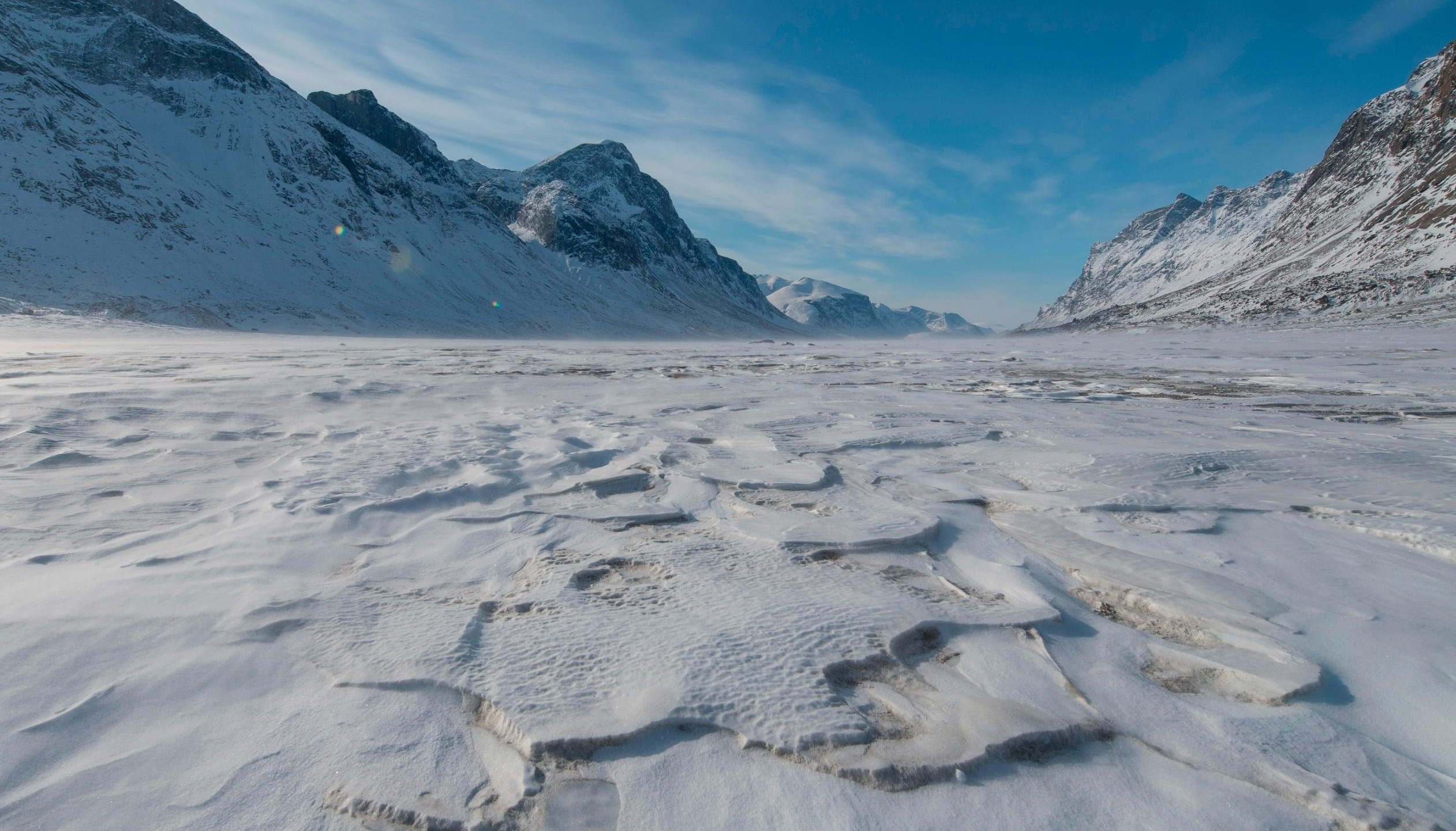 Mountains surround the frozen Weasel River through Akshayuk Pass, in Auyuittuq National Park on April 16, 2017, on Baffin Island, Canada. (Credit: Christopher Morris/Corbis/Getty Images via CNN)