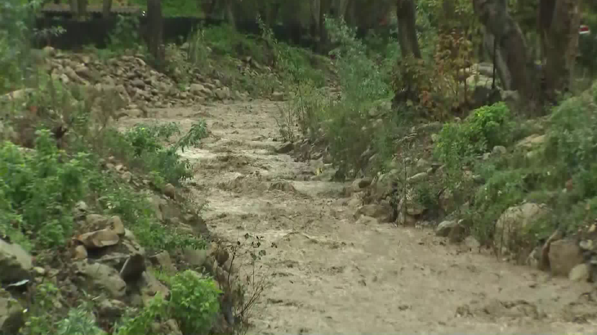 Montecito Creek swelled to a fast-moving river amid a powerful winter storm on Jan. 17, 2019. (Credit: KTLA)