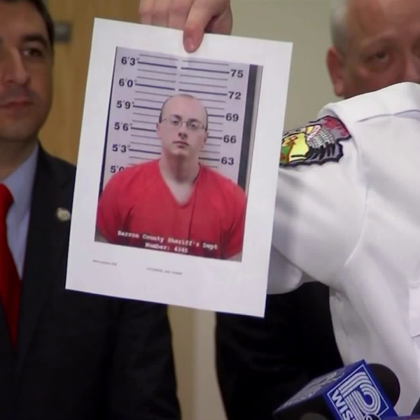 Jake Thomas Patterson is shown in a photo held up by Barron County Sheriff Chris Fitzgerald at a news conference on Jan. 11, 2019. (Credit: CNN)